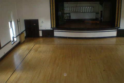 Dancehall Refinish- Refinished with game lines and patching.